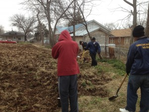 Volunteers using shovels to prepare vacant lot